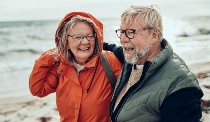 a couple smiling on the beach